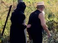Elderly Amish couple walking outside