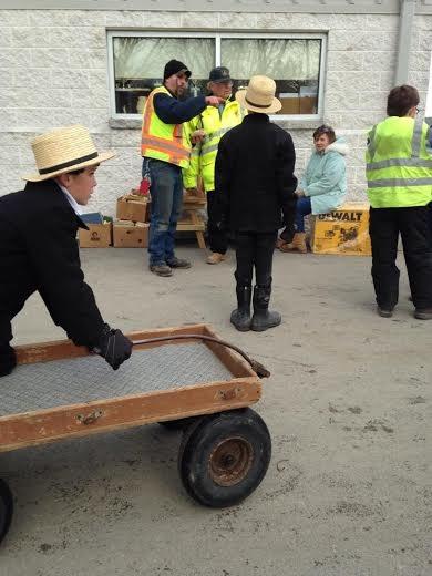 amish-boy-wagon-mud-sale