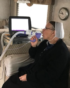 Amish woman demonstrating a lung function test. Source: University of Maryland School of Medicine