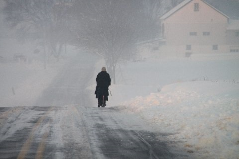 amish-woman-scootering-in-snow