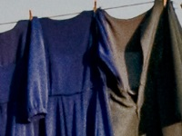 Blue and green dresses drying