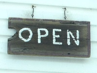 "Rustic wooden ""Open"" sign"