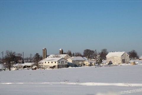 snow-covered-amish-farmstead