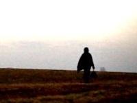 Solo person walking in field